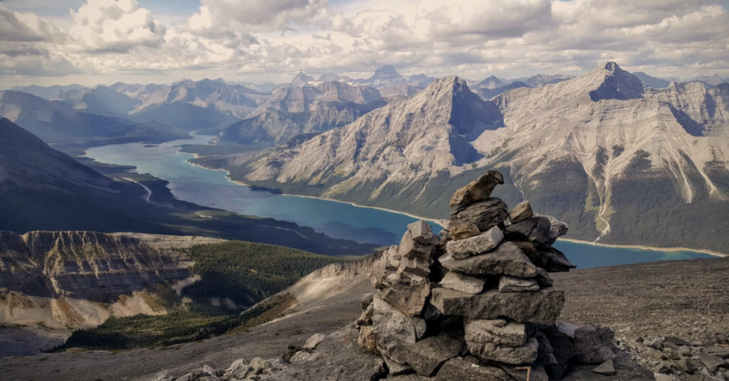 An inukshuk overlooking the rocky mountains.
